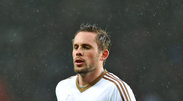 Swansea must keep Gylfi Sigurdsson and not become a selling club, says the defender Neil Taylor.
