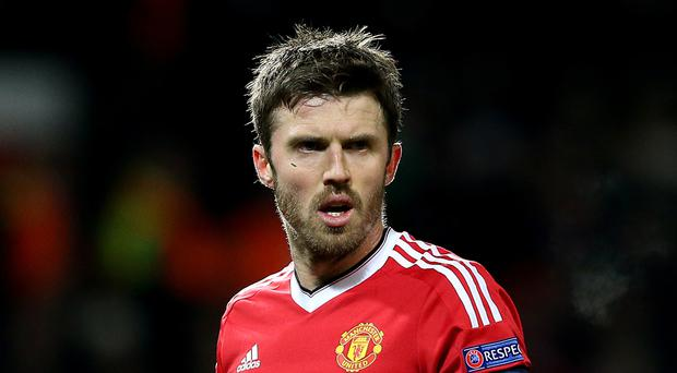 Michael Carrick is staying with Manchester United