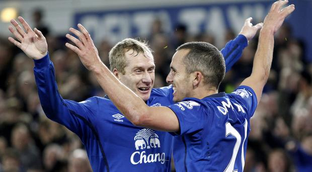Tony Hibbert, left, and Leon Osman have been released by Everton