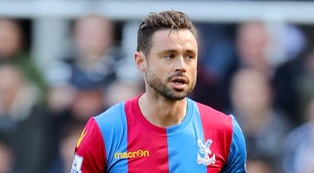 Crystal Palace's Damien Delaney has joined Julian Speroni in committing to the club for a further 12 months