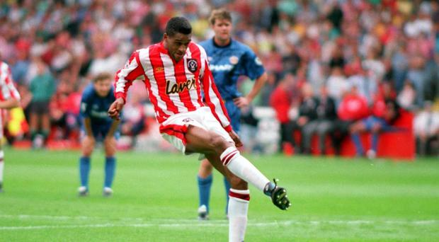 Sheffield United's Brian Deane scores against Manchester United in 1992