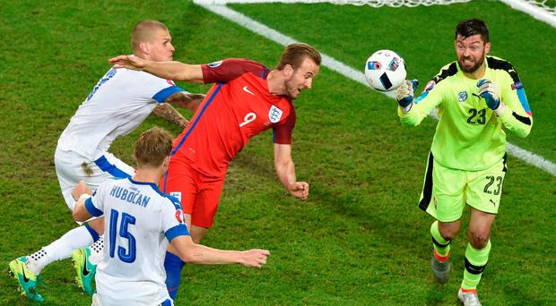 Slovakia goalkeeper Matus Kozacik foils Harry Kane Photo: AFP/Getty Images