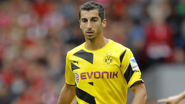 Henrikh Mkhitaryan has completed his move to Manchester United