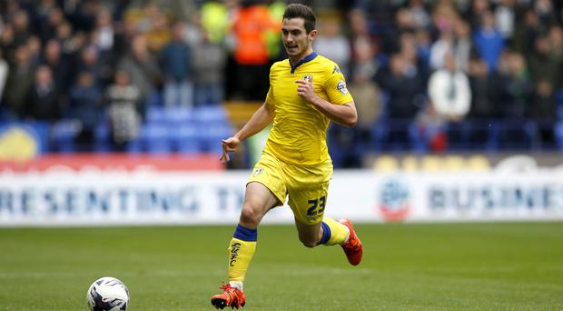 Leeds United's Lewis Cook during the Sky Bet Championship match at the Macron Stadium, Bolton.