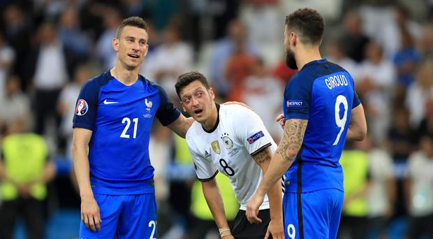 Arsenal team-mates Laurent Koscielny (left), Mesut Ozil (centre) and Olivier Giroud (right) have been given extra time off following international duty at Euro 2016