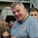 Sam Allardyce signs autographs before Sunderland's 3-0 friendly victory at Hartlepool