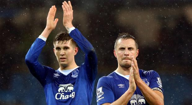 Everton's Phil Jagielka, right, and John Stones will miss the first pre-season friendly at Barnsley