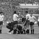 A Uruguayan player receives treatment for an injury during the opening match of the 1966 World Cup at Wembley Stadium between England and Uruguay, while Nestor Concalves takes a drink, also seen are Jimmy Greaves and Bobby Charlton. Photo: Cattani/Fox Photos/Hulton Archive/Getty Images