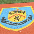 Burnley have apologised to Bradford after a supporter was ejected from Valley Parade following an alleged racist incident