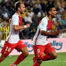 Monaco's Radamel Falcao (right) celebrates with his team-mate Valerie Germain after scoring a goal during their 2-1 Champions League third qualifying round defeat to Fenerbahce. Photo: AFP/Getty