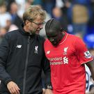 Liverpool manager Jurgen Klopp (left) has reassured Mamadou Sakho about his future after the defender was sent home from the tour of the United States.