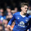 Everton's wantaway defender John Stones, pictured, has been praised for his attitude by assistant manager Erwin Koeman