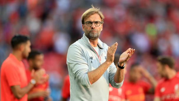 Liverpool boss Jurgen Klopp applauds after his team's Wembley win over Barcelona