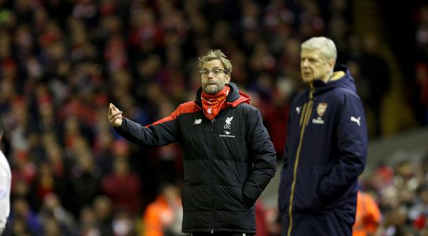 Jurgen Klopp, left, said Arsenal's direct approach caused Liverpool problems in January