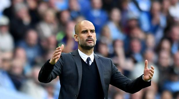 Pep Guardiola won his first game as Manchester City manager with a hard-fought 2-1 victory over Sunderland.
