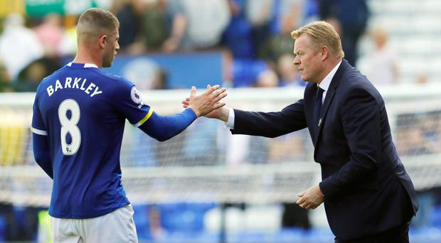 Ronald Koeman shakes hands with Ross Barkley after the final whistle