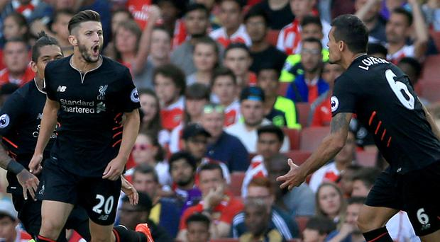 Adam Lallana, left, scored Liverpool's second to put the visitors on course for victory over Arsenal