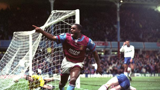 Dalian Atkinson celebrates scoring for Aston Villa against Ipswich, his first professional club