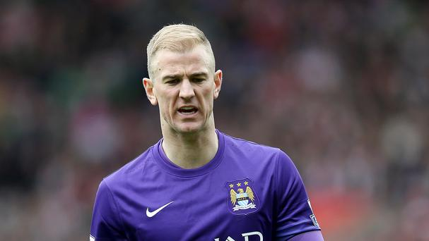 Joe Hart, pictured, played under Mark Hughes at Manchester City