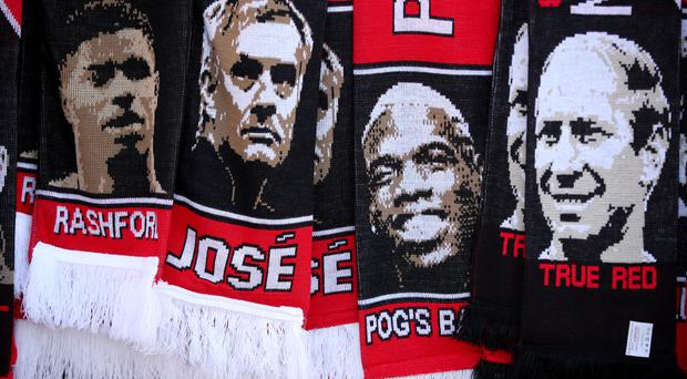 Manchester United scarves for sale before the Premier League match at Old Trafford