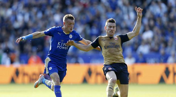 Leicester's Jamie Vardy (left) scored three goals in two games against Arsenal last season.