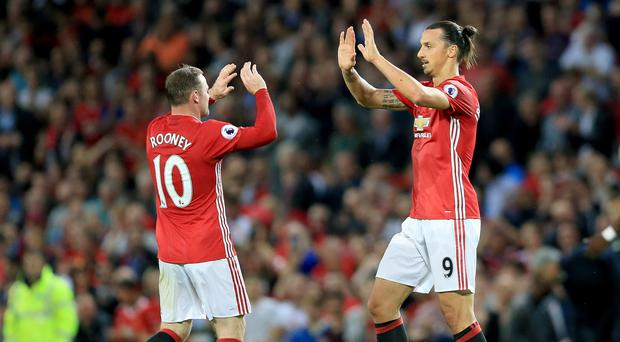 Manchester United captain Wayne Rooney, left, has handed penalty duty to Zlatan Ibrahimovic, right