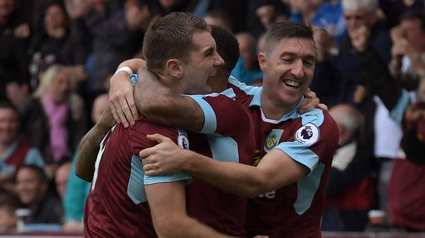 Sam Vokes, pictured left, opened the scoring for Burnley against Liverpool at Turf Moor