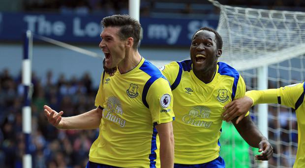Gareth Barry, left, celebrates scoring the match winner against West Brom