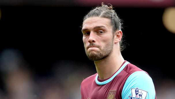 West Ham's Andy Carroll is facing up to six weeks out with a knee injury
