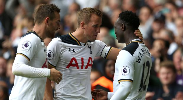 Harry Kane, centre, and Vincent Janssen, left, congratulate Victor Wanyama on Saturday