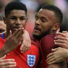 Manchester United striker Marcus Rashford, left, celebrates scoring on his senior England debut against Australia last season
