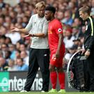 Liverpool's Daniel Sturridge, centre, was named on the bench against Tottenham