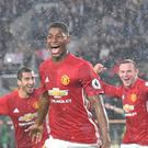 Marcus Rashford (centre) scored Manchester United's winner at Hull on Saturday having been set up by Wayne Rooney (right).