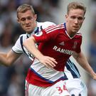 Middlesbrough's Adam Forshaw beats West Brom's Darren Fletcher to the ball during their 0-0 draw on Sunday.