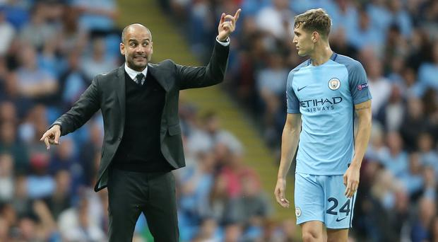 England defender John Stones, right, is already learning from Manchester City boss Pep Guardiola