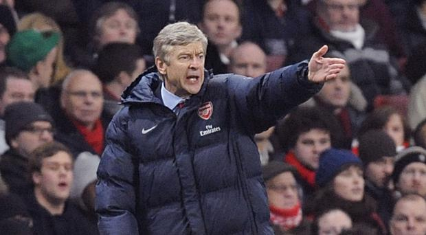 Arsenal manager Arsene Wenger (pictured) has bolstered his squad with the signing of forward Lucas Perez from Deportivo La Coruna