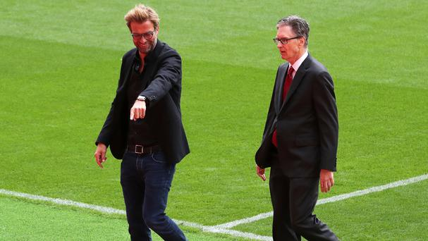 Liverpool manager Jurgen Klopp, left, with owner John Henry ahead of the opening of the Anfield Main Stand which they believe will help close the gap on their rivals