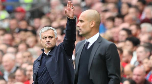 Pep Guardiola, right, got the win over Jose Mourinho's Manchester United