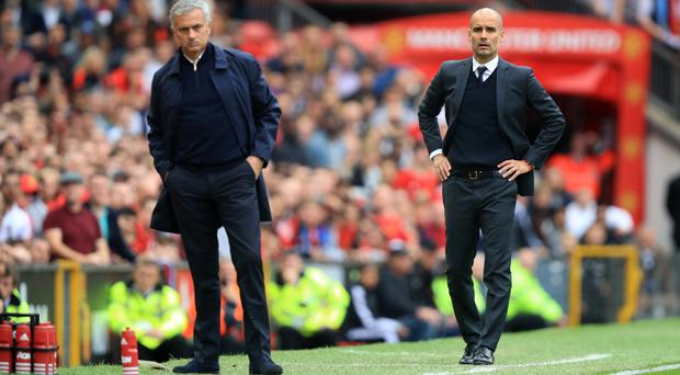 Manchester United manager Jose Mourinho, left, and Manchester City boss Pep Guardiola on the touchline at Old Trafford