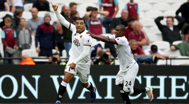 Troy Deeney, left, celebrates scoring Watford's second goal of the game against West Ham