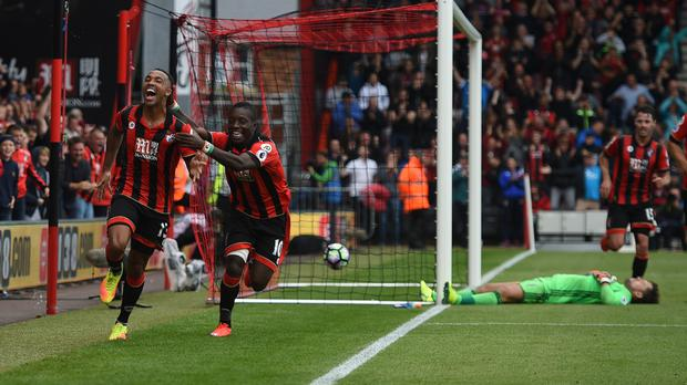 Callum Wilson, left, earned Bournemouth a point