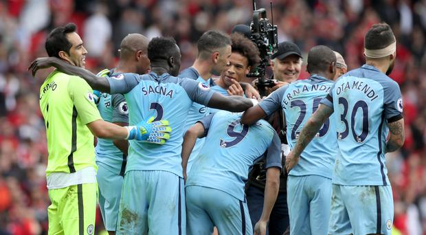 Manchester City's players celebrate their 2-1 derby win at Old Trafford