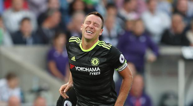 John Terry was injured in the closing stages of Chelsea's draw at Swansea