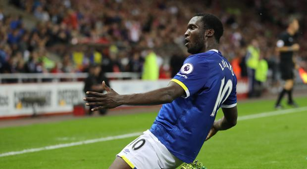 Romelu Lukaku celebrates his hat-trick