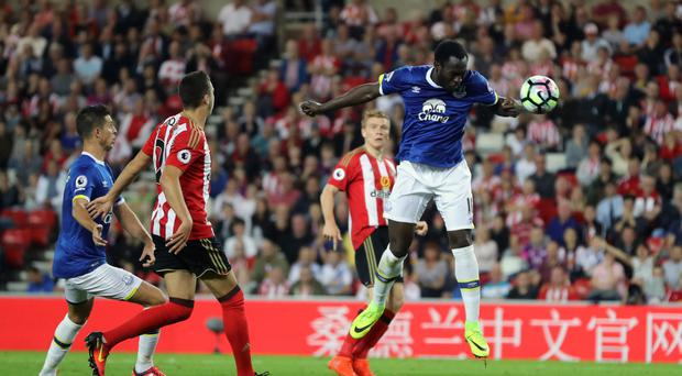 Romelu Lukaku heads in the first of his three goals