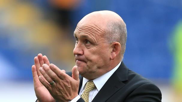Mike Phelan is considering an offer to become Hull's permanent manager