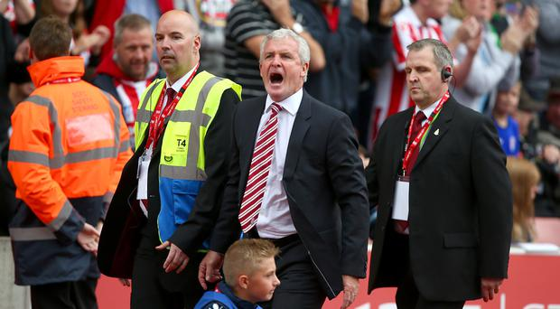 Stoke manager Mark Hughes is sent to the stands during the defeat to Tottenham