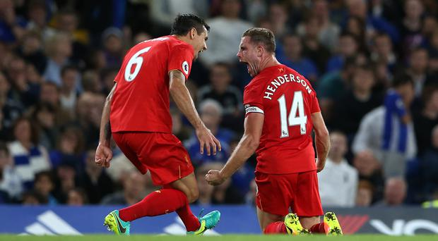 Jordan Henderson, right, celebrates scoring Liverpool's second goal of the game