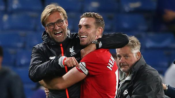 Liverpool manager Jurgen Klopp, left, guided the Reds to a win at Chelsea on Friday night