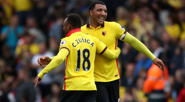 Troy Deeney, right, and Camilo Zuniga helped their Watford side see of Manchester United